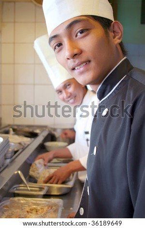two chef smile happy at work - stock photo