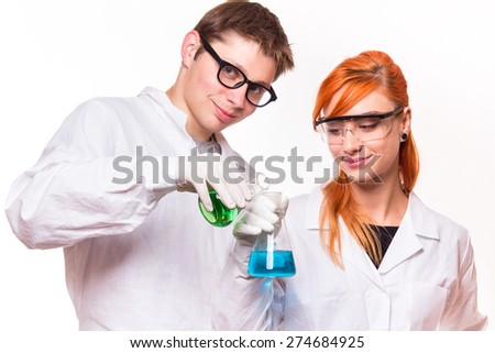Two chemists holding a test tube in a lab - studio shoot  - stock photo