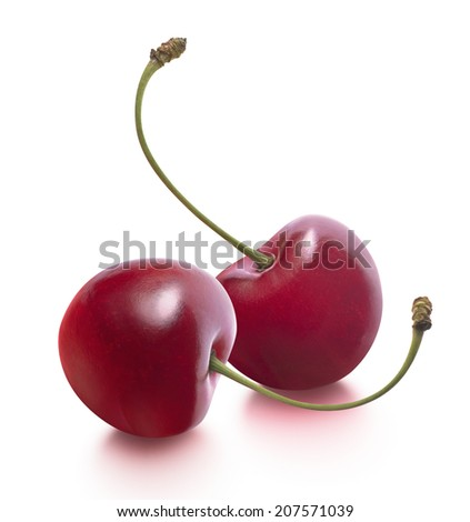 Two cherries separate isolated on white background as package design elements - stock photo