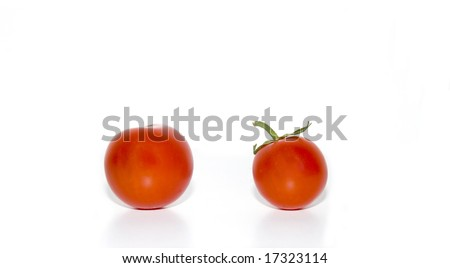 Two Cherry tomatoes with water droplets isolated on white background. - stock photo