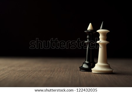 two chess kings on black background - stock photo