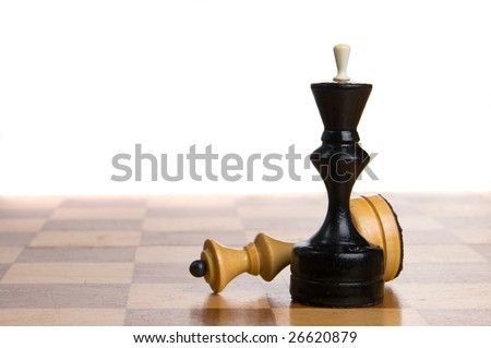 Two chessmen on a chessboard, white background