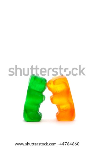 Two chewy candy bears kissing - stock photo
