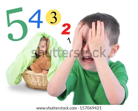 Two children are playing Hide and Go Seek on a white isolated background. There are math numbers for a countdown. The kids are happy. - stock photo