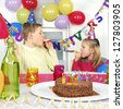 Two children at birthday party - stock photo