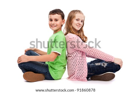 Two children back to back - stock photo