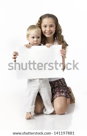 two children, brother and sister holding banner - stock photo