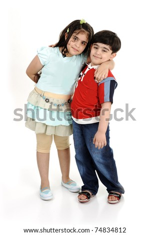 Two children, brother and sister, isolated on white, mixed race - stock photo