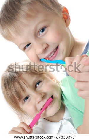 two children cleaning  teeth over white background - stock photo