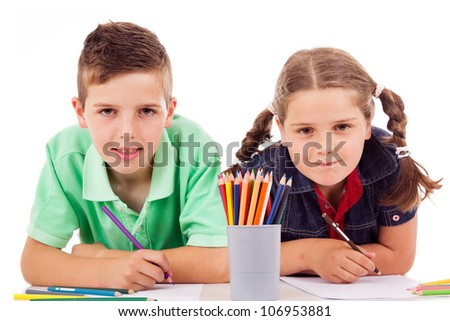 Two children drawing with colorful crayons and smile, isolated over white - stock photo