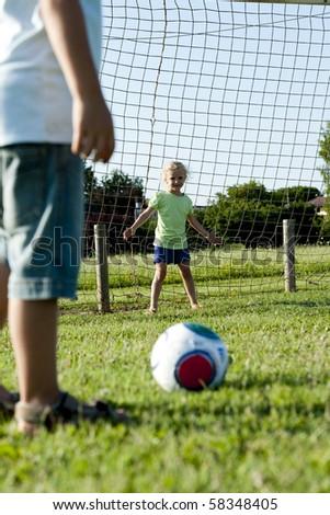 Two children enjoying playing soccer - stock photo