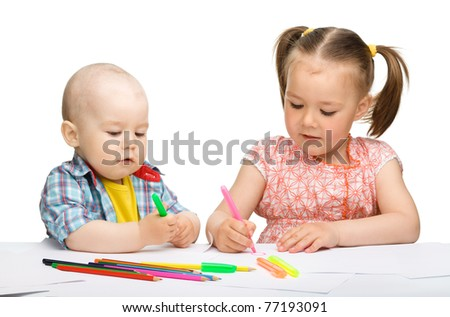 Two children, girl and boy, are drawing on paper using markers, isolated over white
