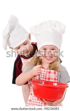 two children in chef's hat isolated on white background - stock photo