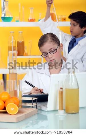 Two children in laboratory - stock photo