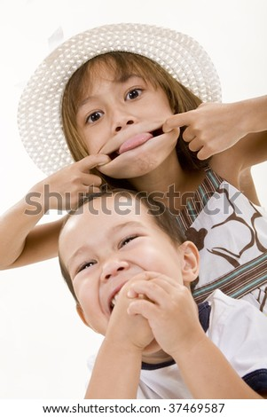 Two Children Making Faces - stock photo