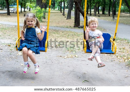 Two children on old swing