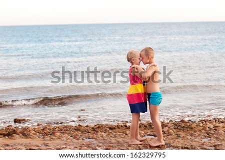 two children on the beach - stock photo