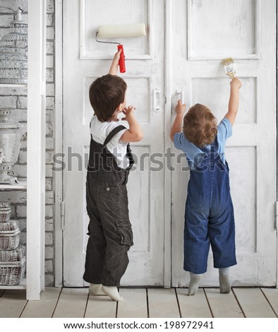two children paint indoors - stock photo