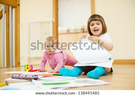 Two  children playing together in home - stock photo