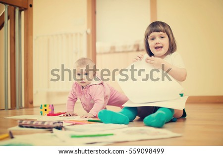 Two  children playing together in home