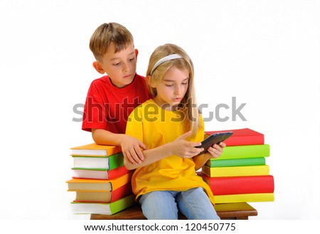 Two children read e-book surrounded by several books isolate on white background - stock photo
