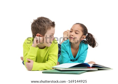 Two children reading books - stock photo