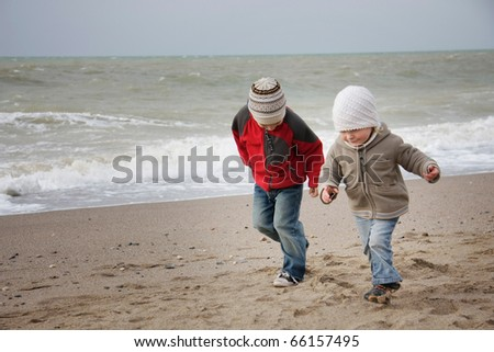 two children running on beach