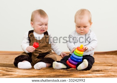 two children shared a toy - stock photo
