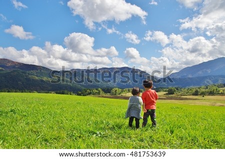 Two children standing on the plateau