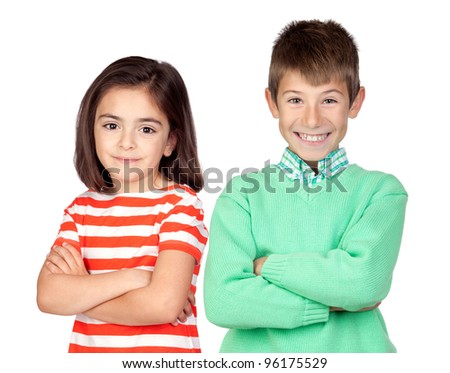 Two children with crossed arms isolated on white background - stock photo