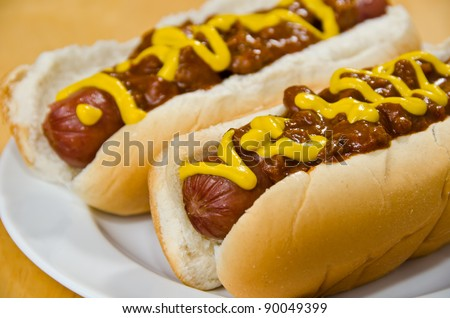 Two Chili Dogs on a White Plate - stock photo