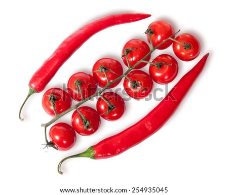 Two chili pepper and cherry tomatoes on stem top view isolated on white background - stock photo