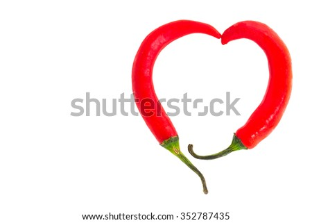Two chili peppers forming a shape of heart. Hot lover symbol. - stock photo