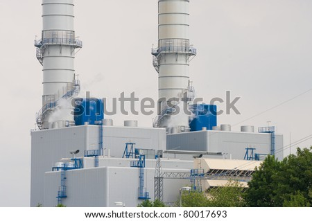 two chimneys as a part of a nuclear plant - stock photo