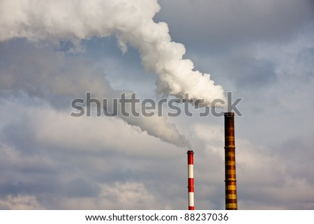 Two chimneys with polluted smoke from power plant