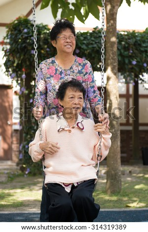 two chinese senior woman in the park