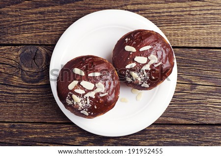 Two chocolate cupcake with nuts on wooden table. Top view - stock photo