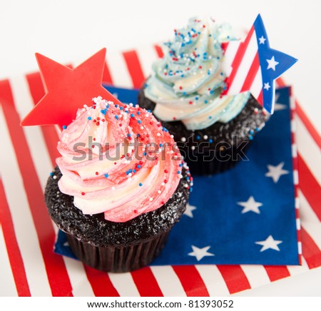 Two Chocolate Cupcakes with Red and Blue Frosting for Independence Day - stock photo