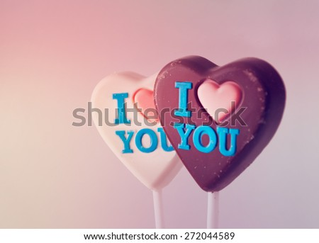 "Two chocolate hearts with ""I love you"" inscription, filtered. - stock photo"
