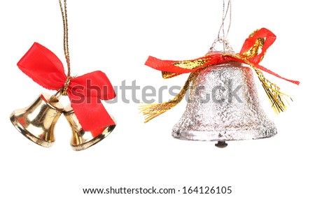 Two christmas jingle bells with red ribbon. Isolated on a white background.