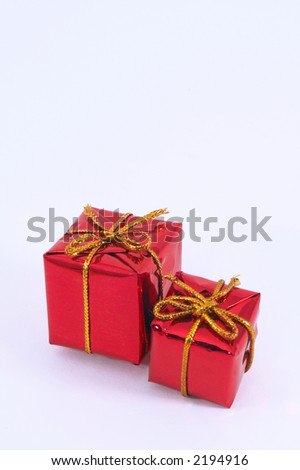 Two Christmas present on white background. with space for text - stock photo