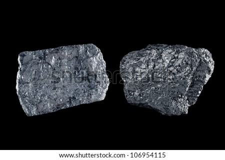 Two chunks of bituminous coal use to generate power isolated on black. - stock photo