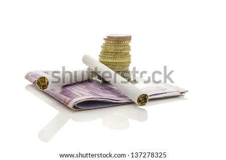 Two cigarettes with stack of Euro coins and banknotes. Isolated over white background. Concept of expensive smoking habit. - stock photo