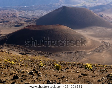 Two cinder cones in Haleakala volcanic crater - stock photo