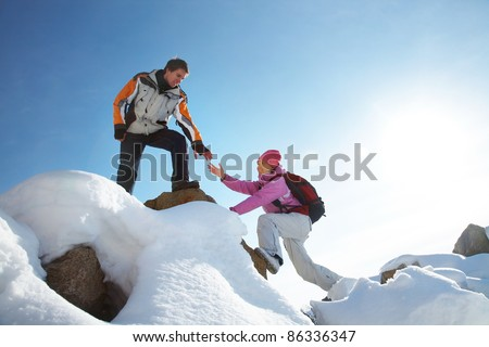 Two climbers ascend the mountain - stock photo