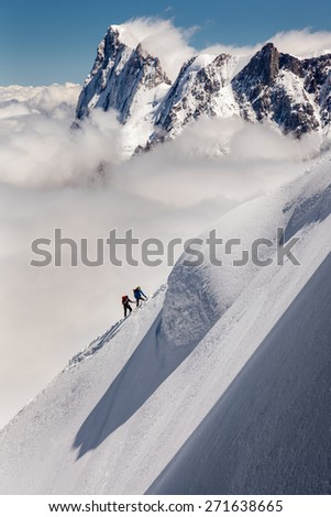 two climbers on the big mountain snow - stock photo