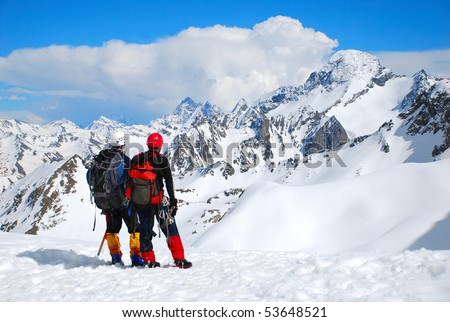 Two climbers on the mountain summit - stock photo