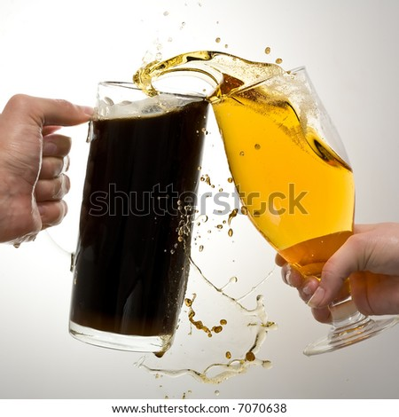 Two clinking glasses. The man and the woman. Dark and light beer. - stock photo