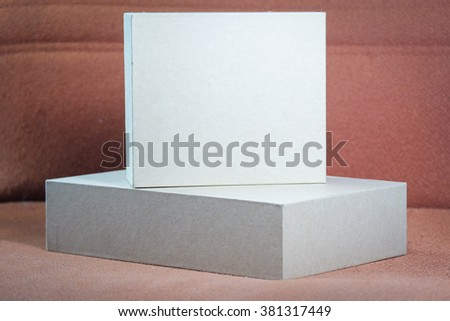 Two closed cardboard Box paper package box isolated with soft shadow