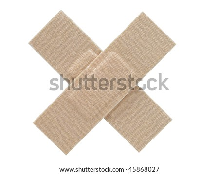 Two cloth plasters placed together to form a cross. Isolated on a white background. - stock photo